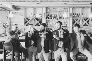 Groom and groomsmen at the full service bar at Cooper's Ridge