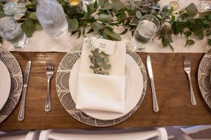 Plate settings inside wedding reception venue